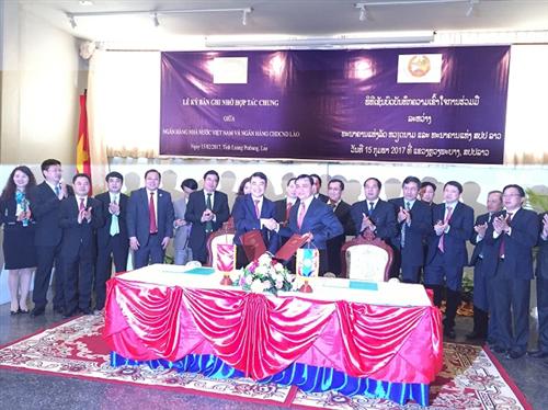 Chủ tịch HĐQT Vietcombank tham gia đoàn công tác của Thống đốc dự Hội nghị song phương lần 6 giữa NHNN Việt Nam và NHCHDCND Lào